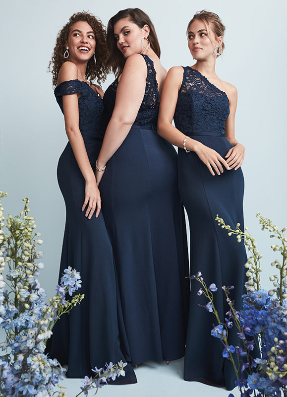 Three bridesmaids in long navy blue bridesmaid dresses