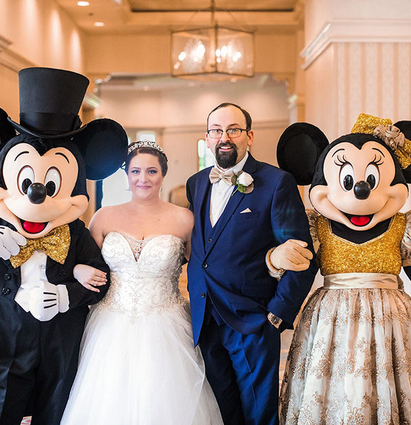Real Weddings Couple Katie and Shane posing with Mini and Micky Mouse.