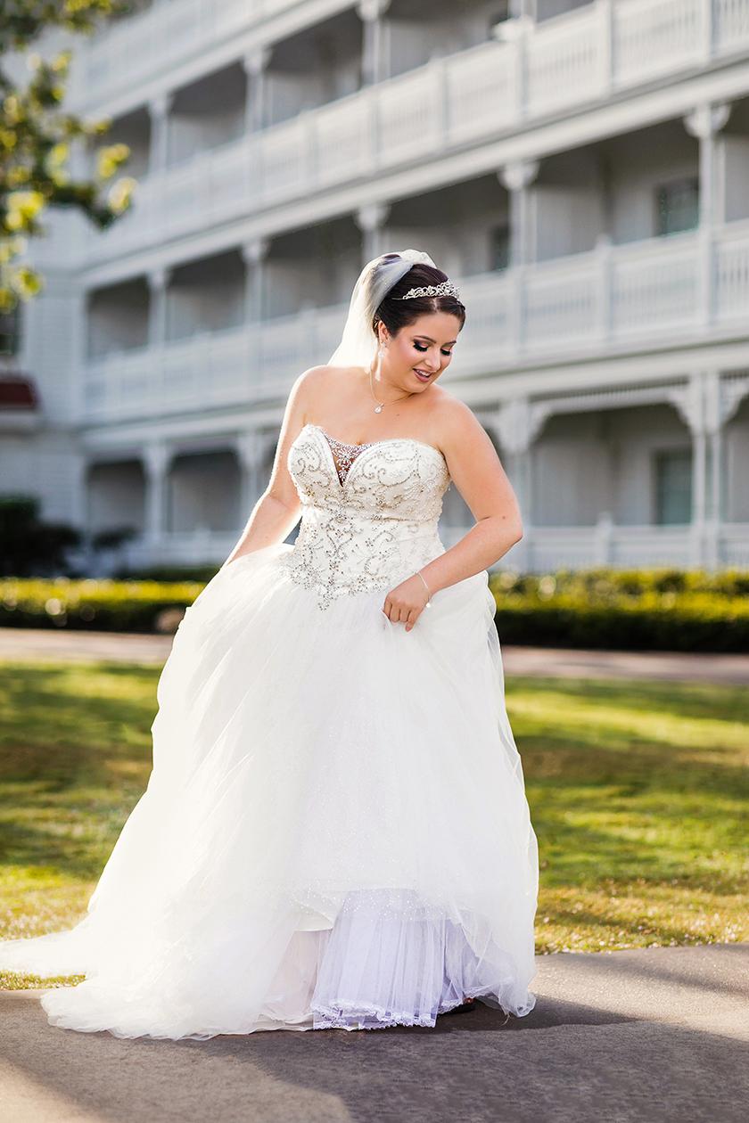 Real Bride Katie posing in her David's Bridal ballgown.