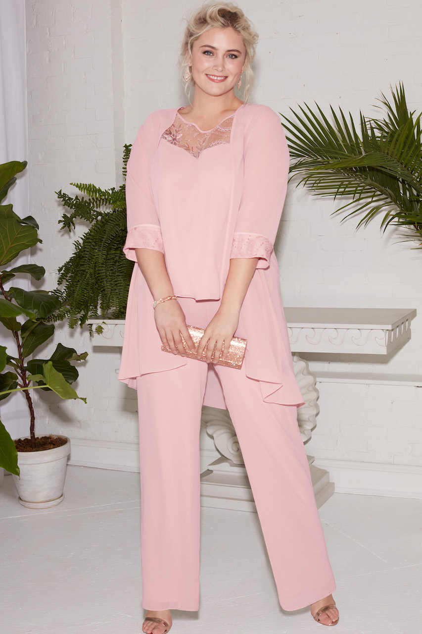 mother of the bride wearing a bright pink pantsuit for a spring wedding