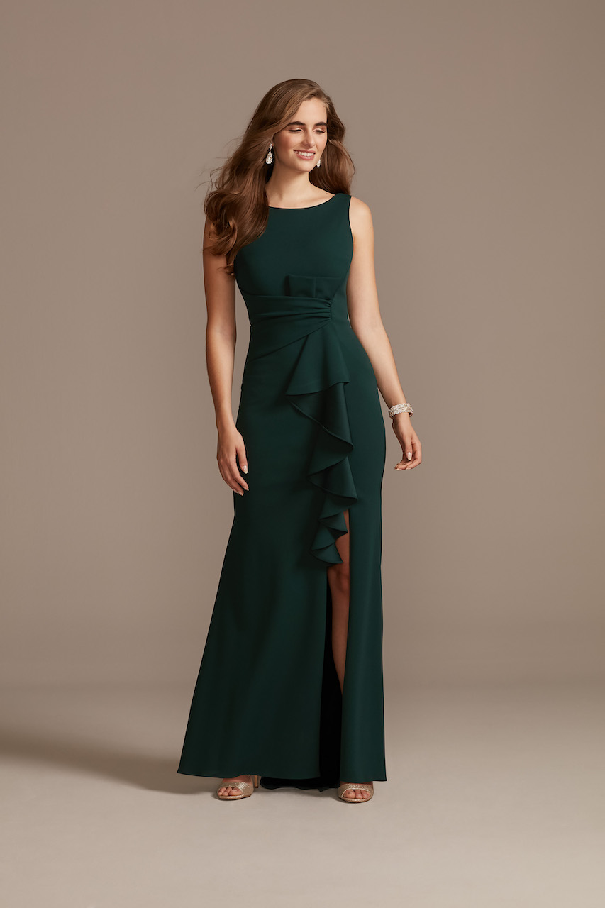 guest of a spring wedding wearing a long formal green dress