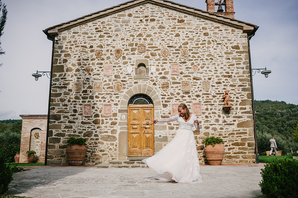 Bride twirling in her dream dress at her non traditional Italian wedding