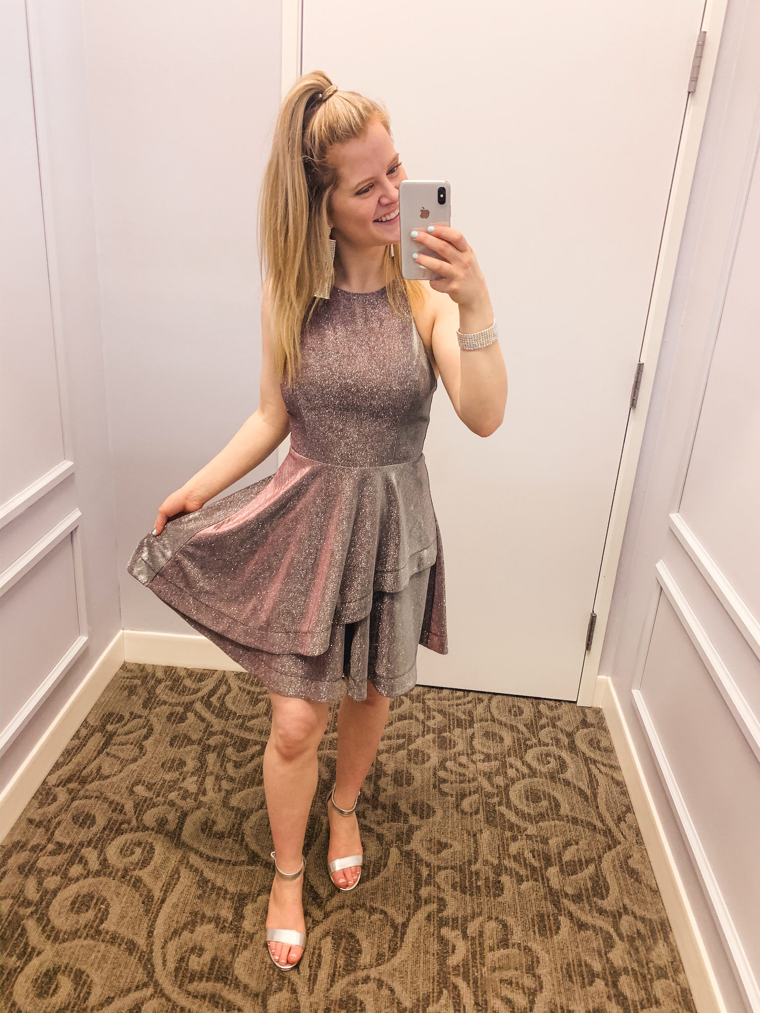 Mirror photo of girl in short prom dress