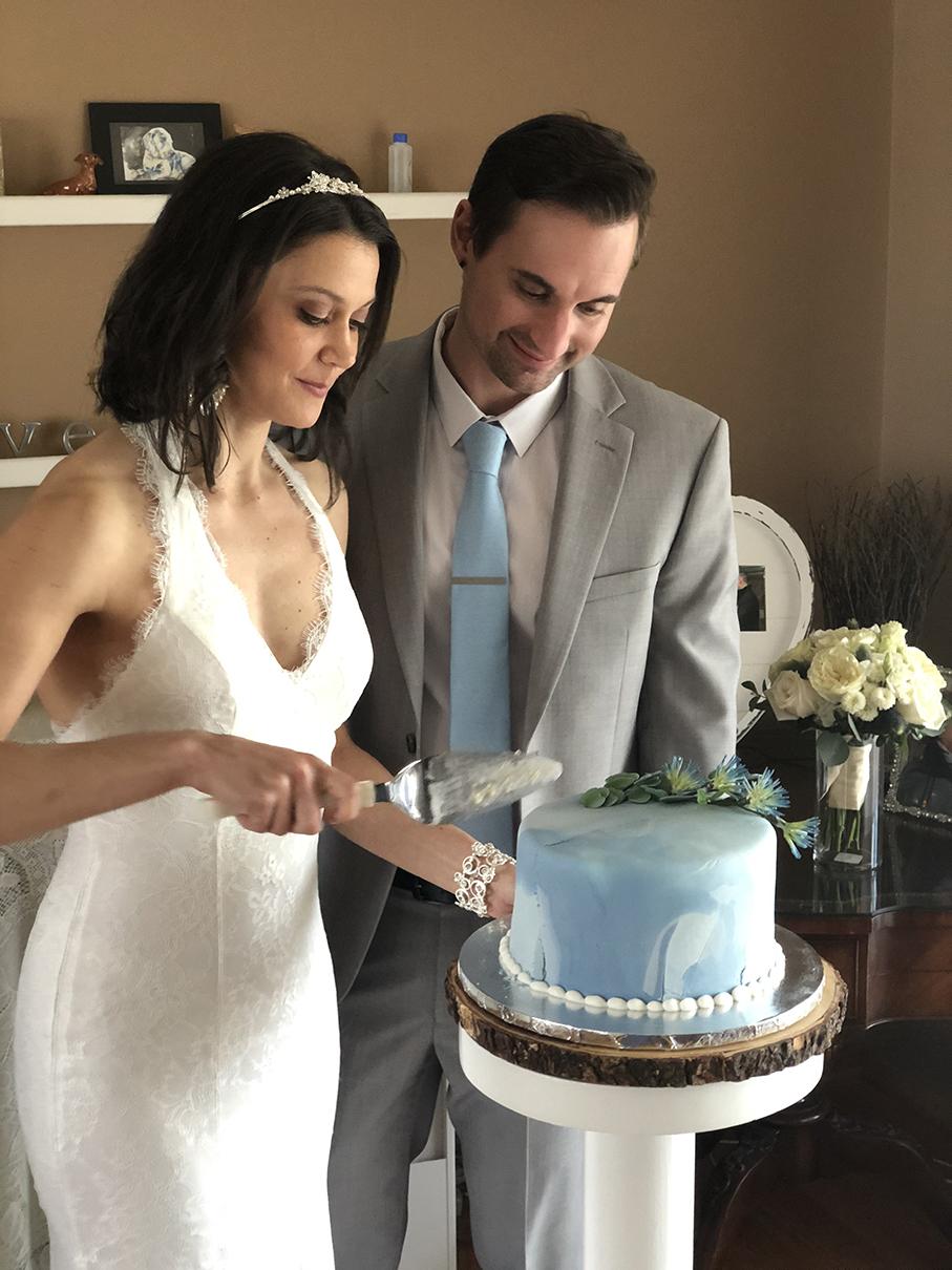 Newlyweds cutting into their wedding cake.