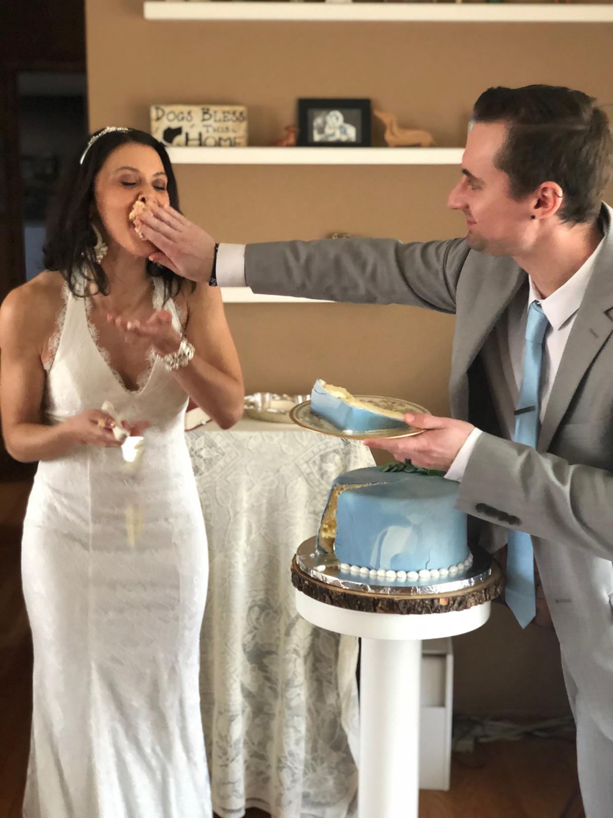 Newlyweds enjoying their first slice of wedding cake.