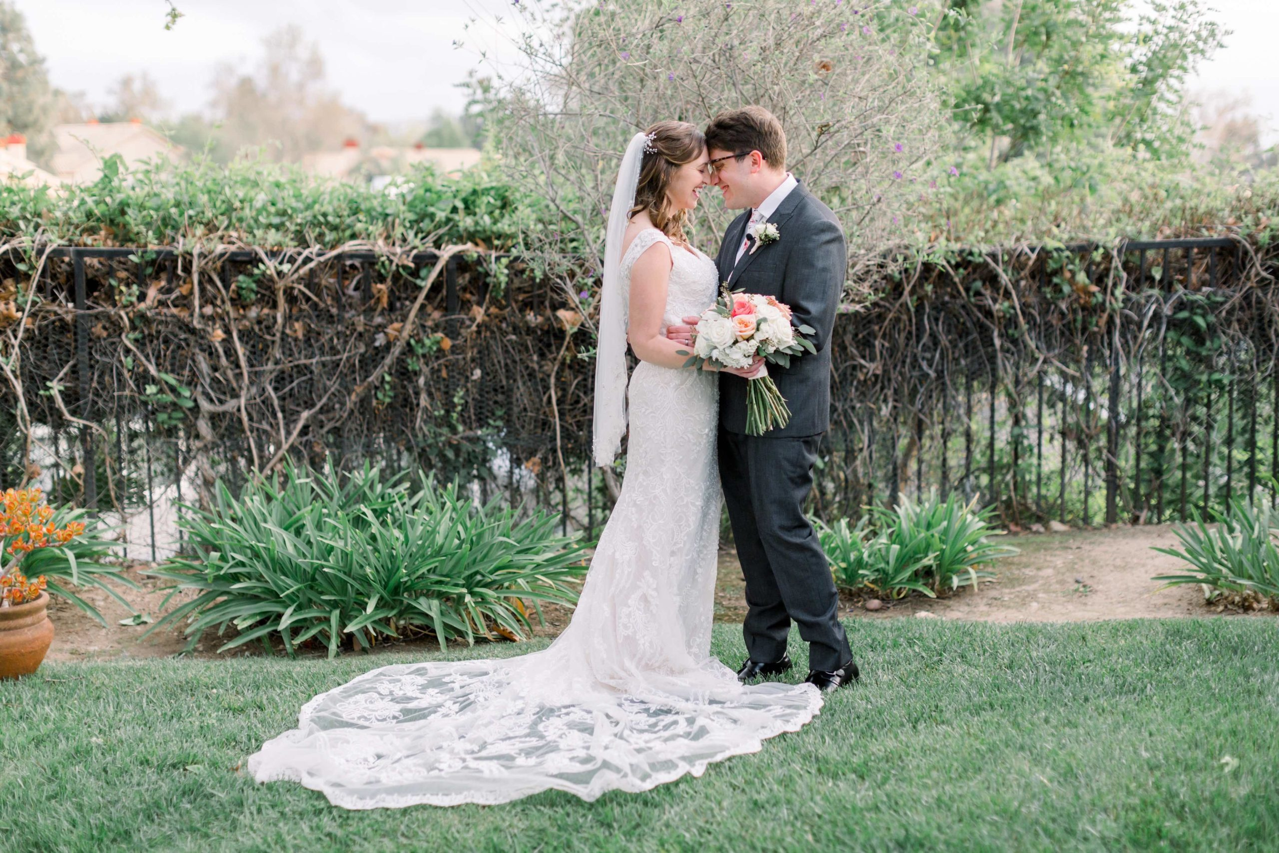 Bride and Groom embracing in backyard wedding