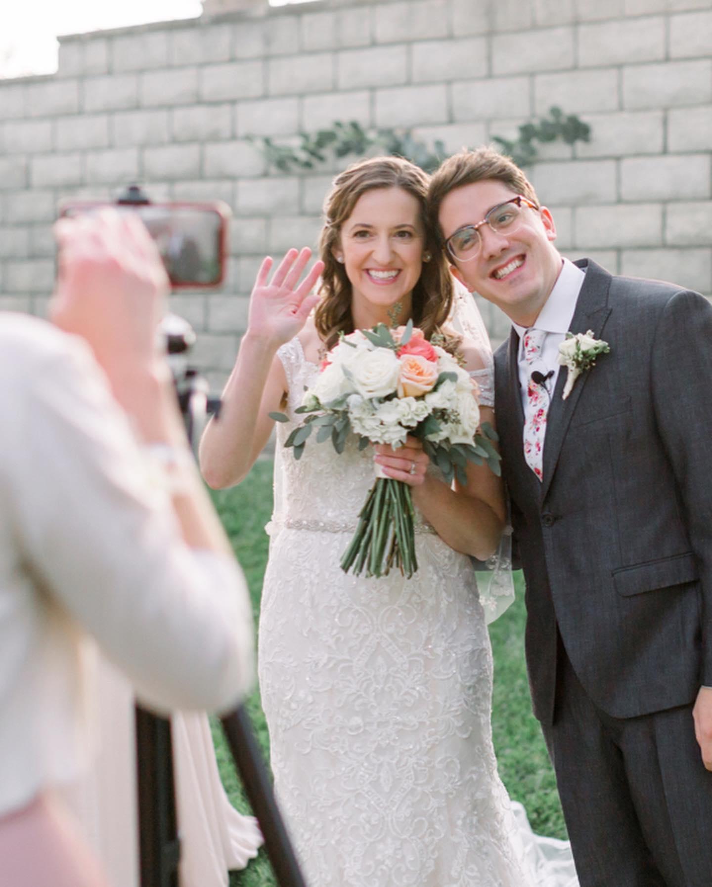 Bride and Groom waving at camera