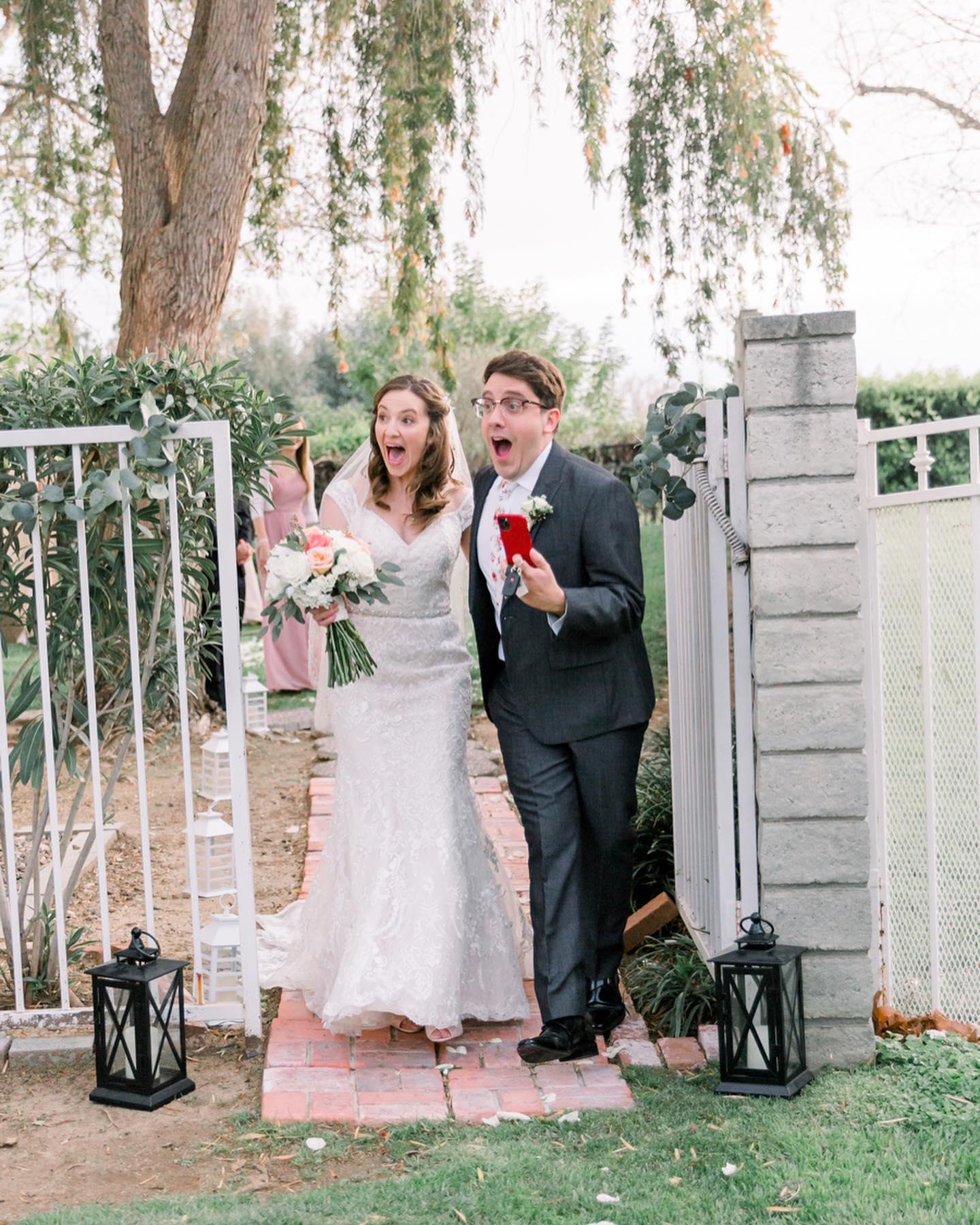 Bride and Groom exiting backyard looking surprised