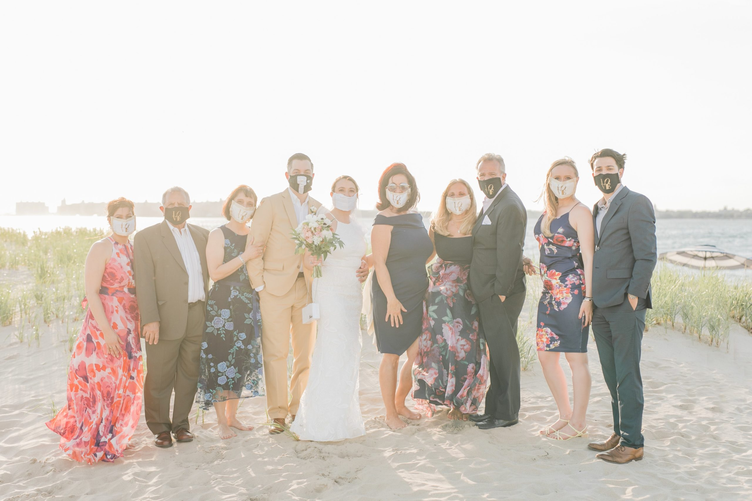 Bride and Groom + family picture on beach