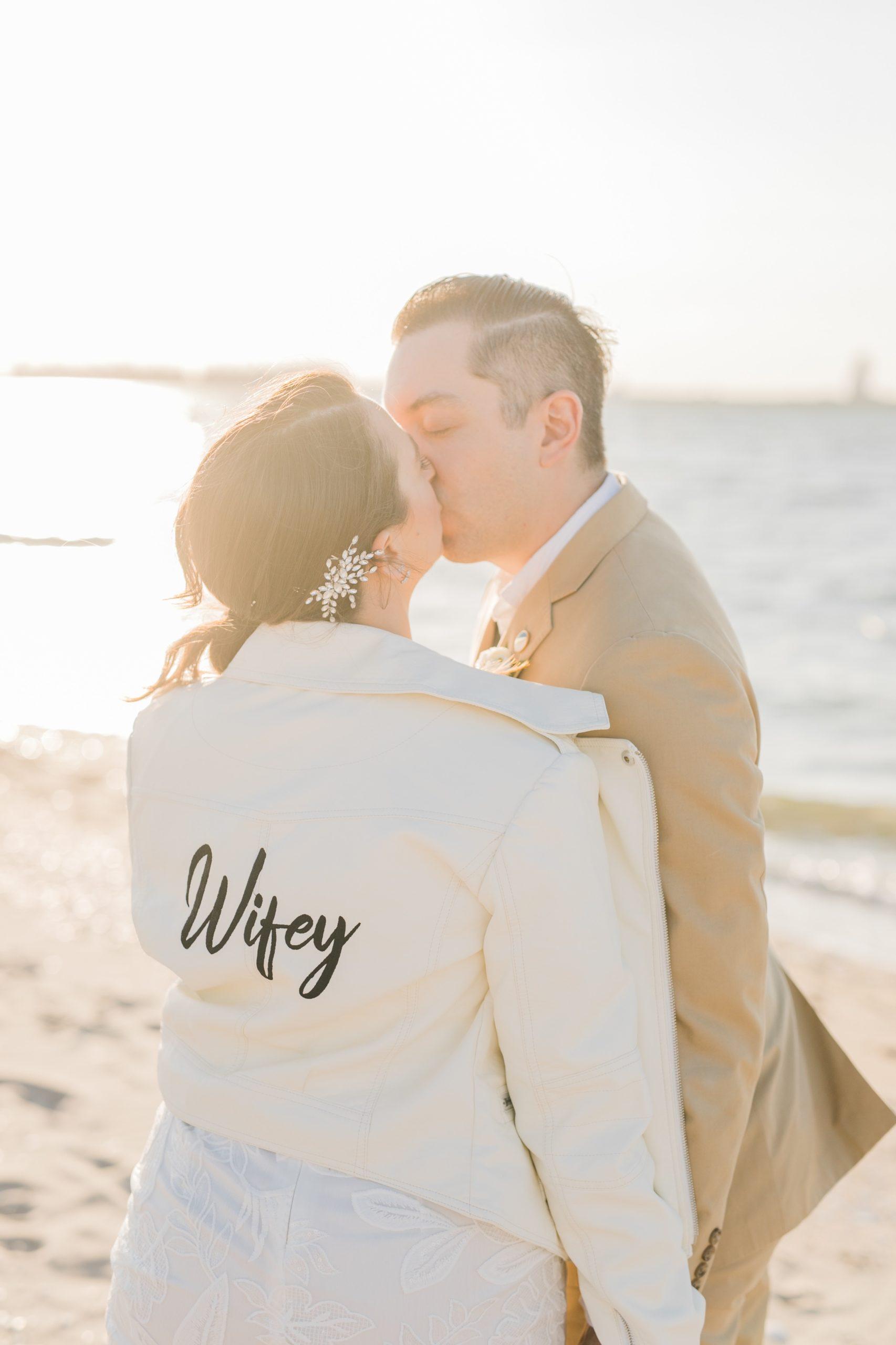 Bride an dGroom kissing on beach