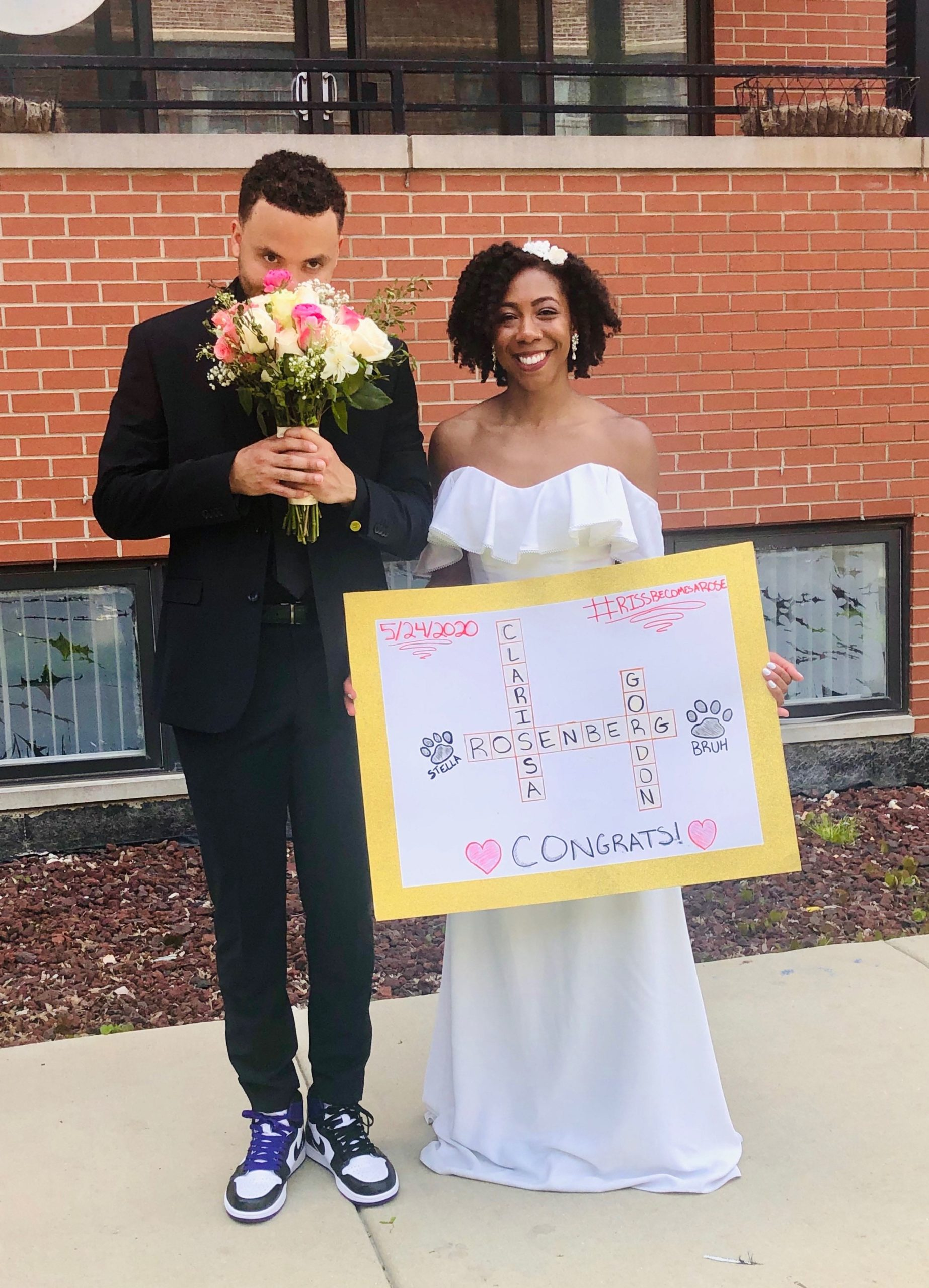 Clarissa and Jordon with drive by signs