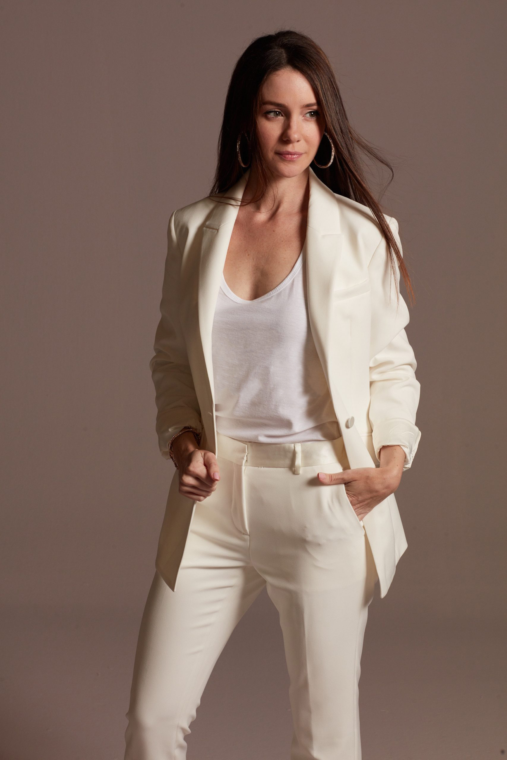 Casually styled white bridal pantsuit
