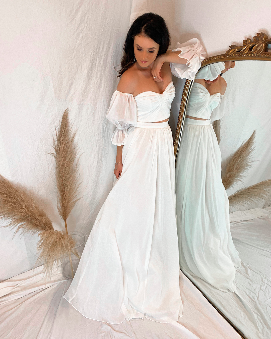bride in modern two piece wedding dress with sleeves