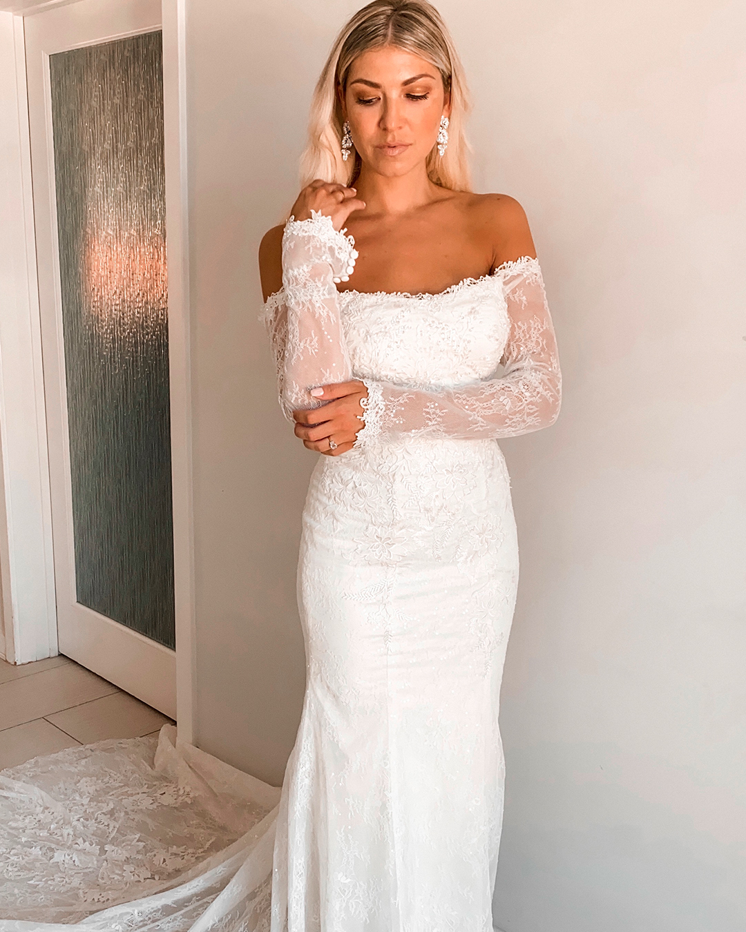 bride in long sleeve lace off the shoulder wedding dress