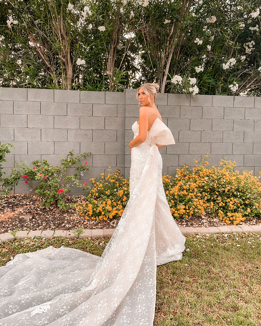 bride in lace wedding dress with dramatic bow train