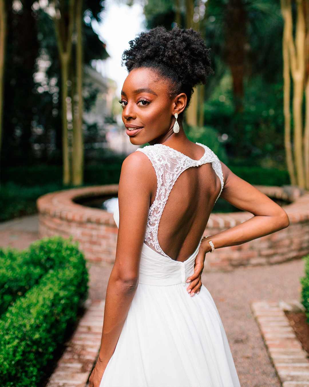 bride in beaded wedding dress with open back