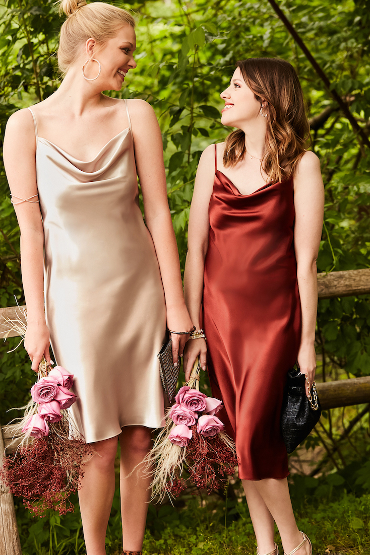 Two girls smiling in short fall bridesmaid dresses