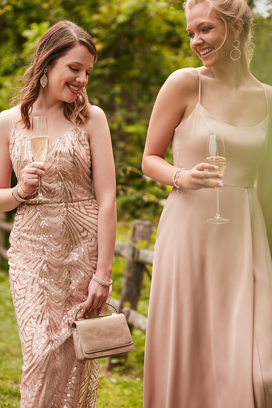 Two girls smiling in fall bridesmaid dresses