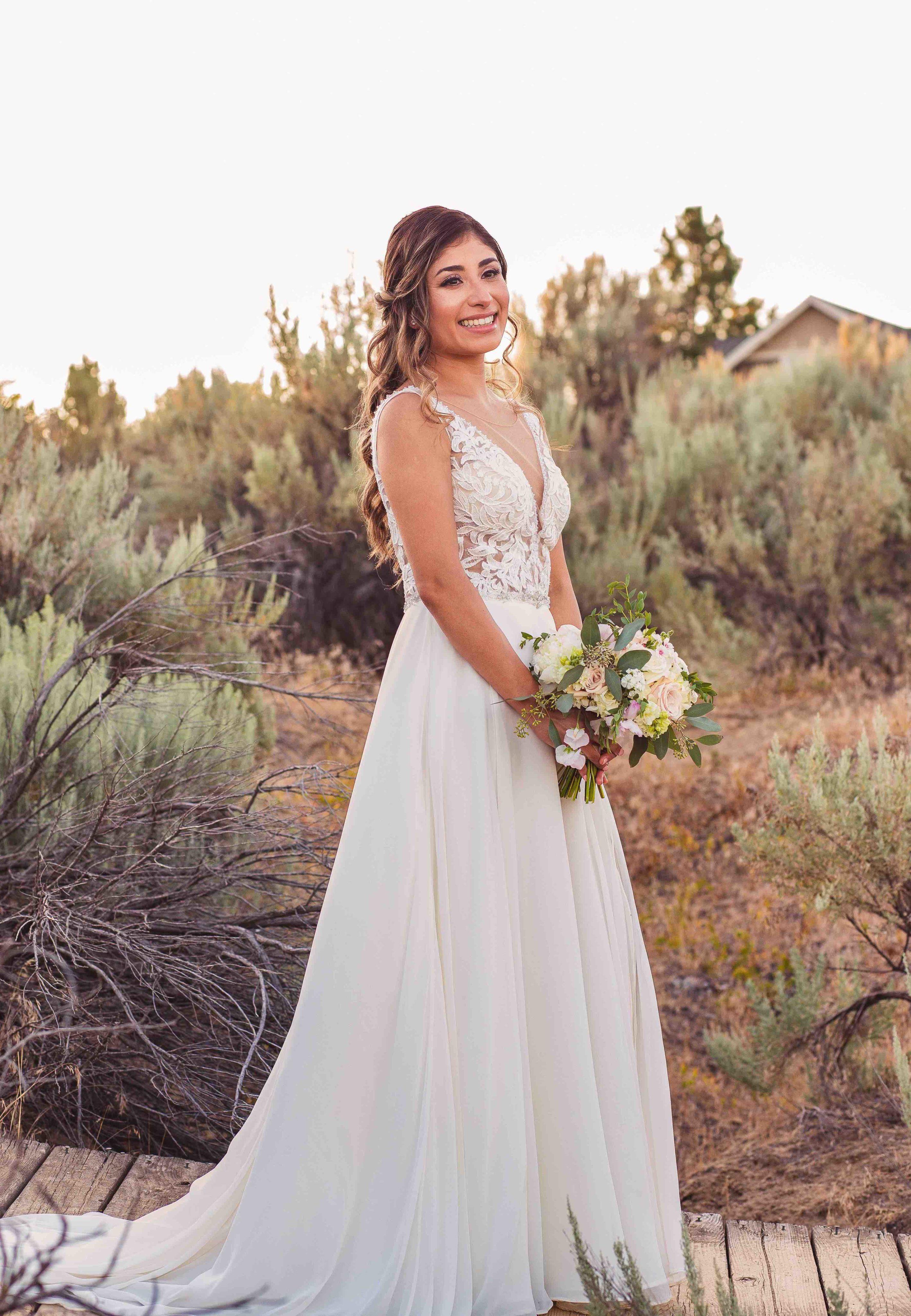 Solo shot of bride holding bouquet