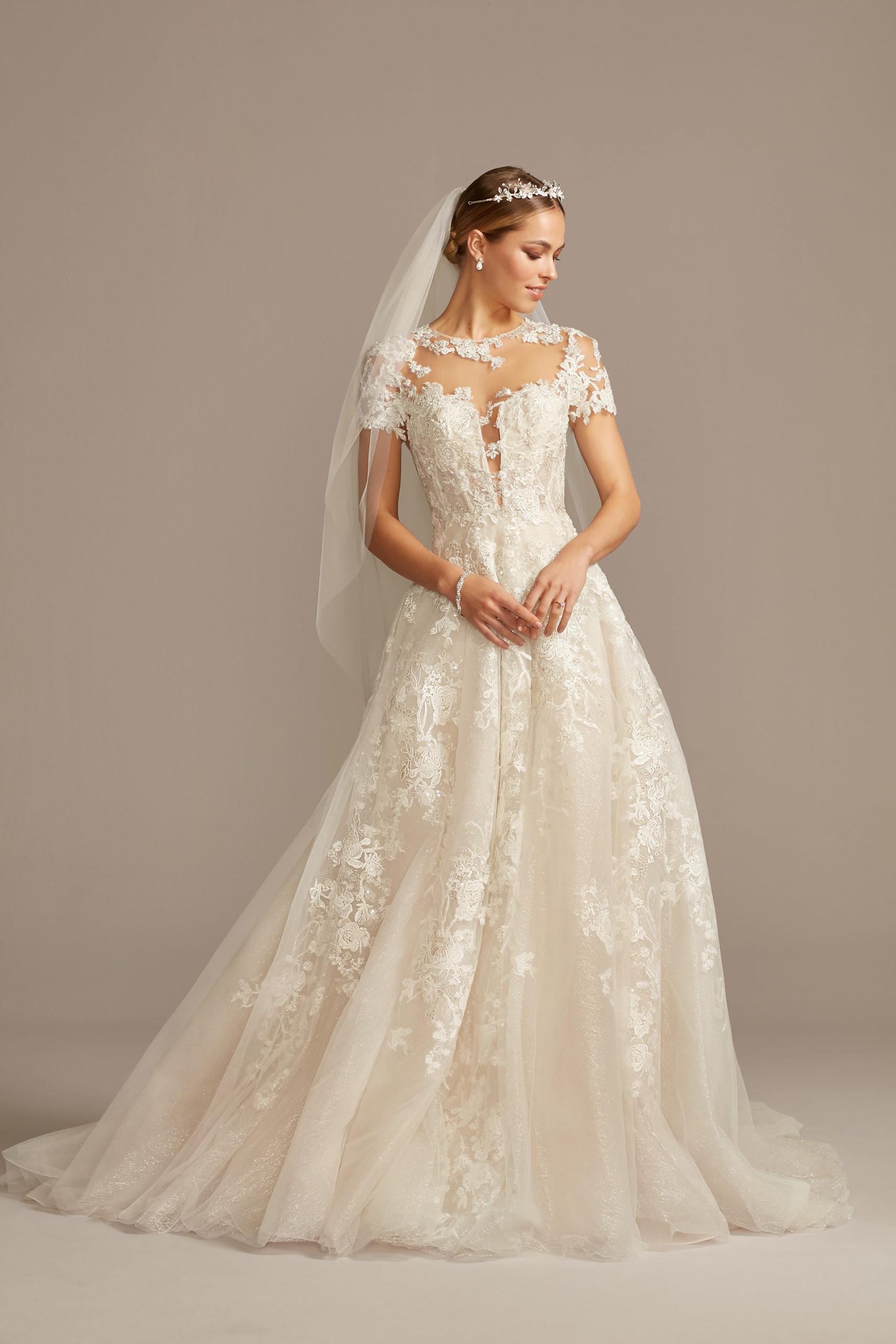 bride wearing wedding dress with short sleeves