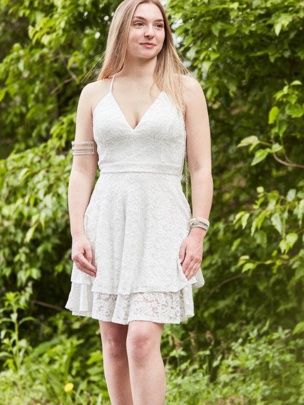 teen wearing white lace party dress