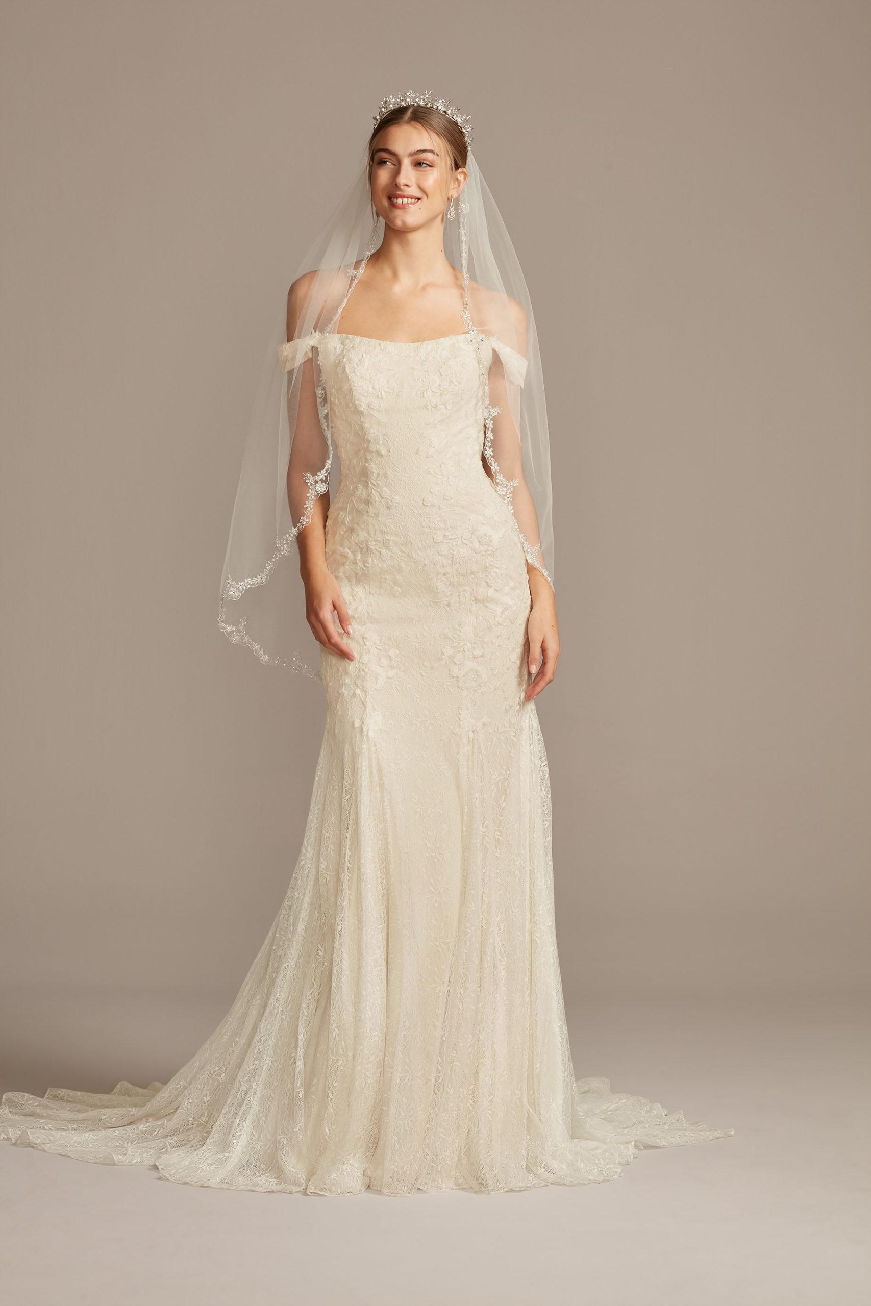 bride wearing wedding dress with swag sleeves