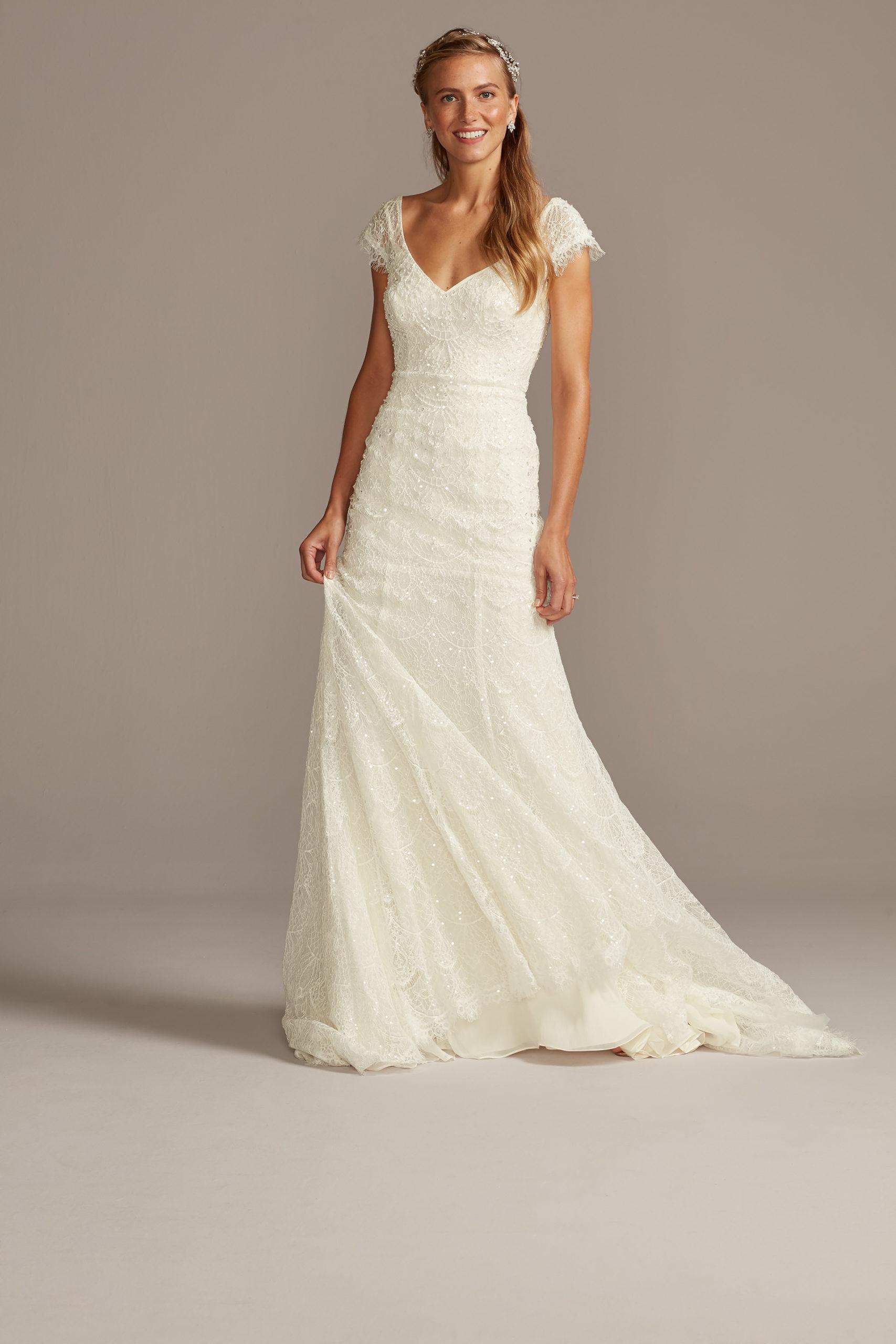bride wearing wedding dress with cap sleeves