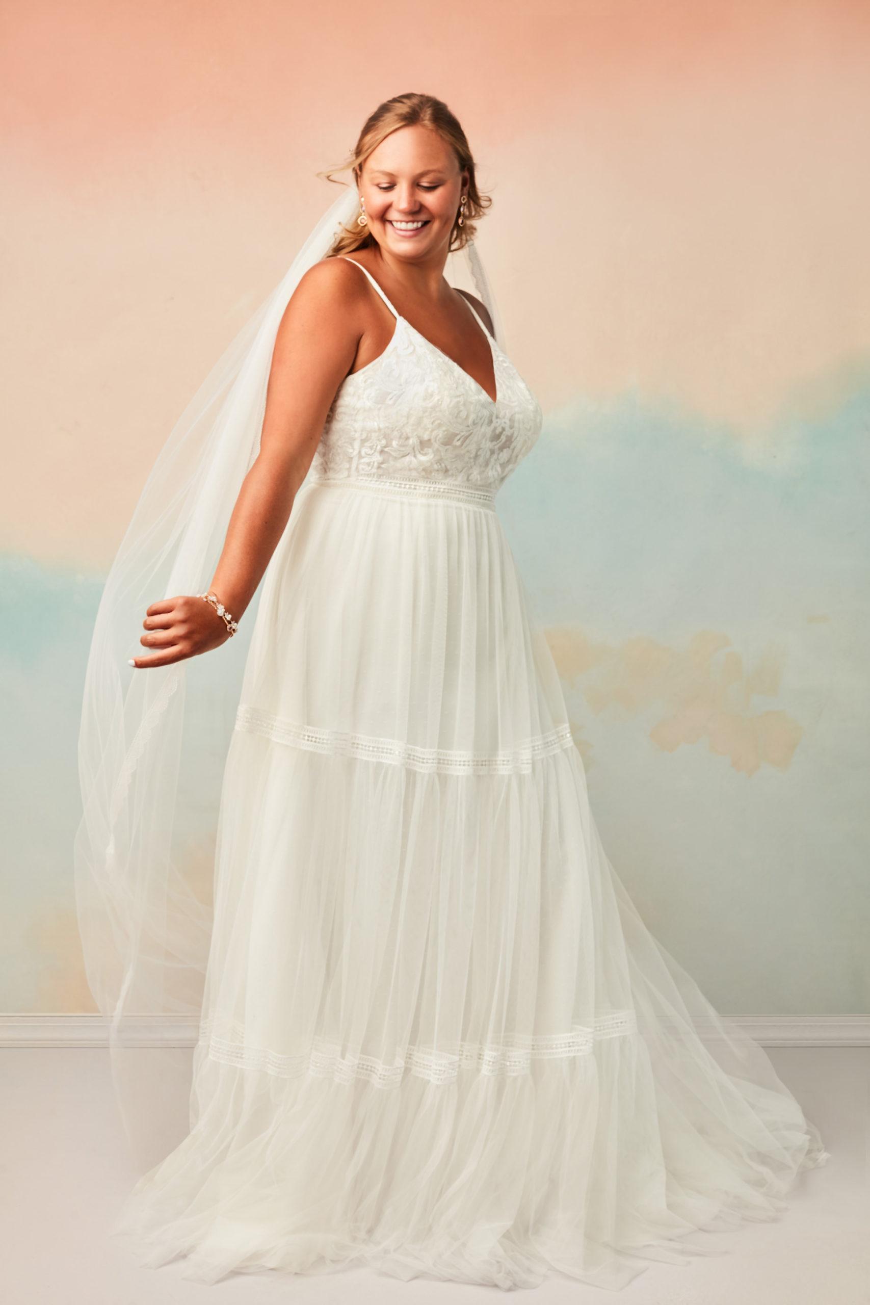 Bride wearing a boho inspired wedding dress