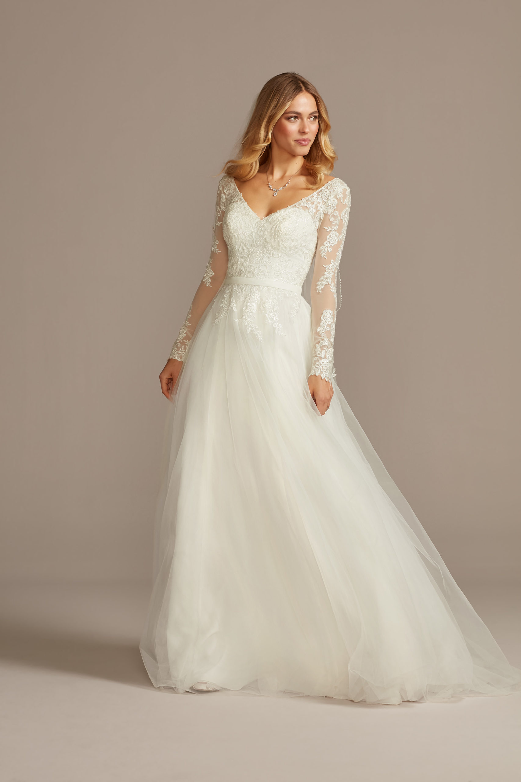 bride wearing wedding dress with illusion sleeves