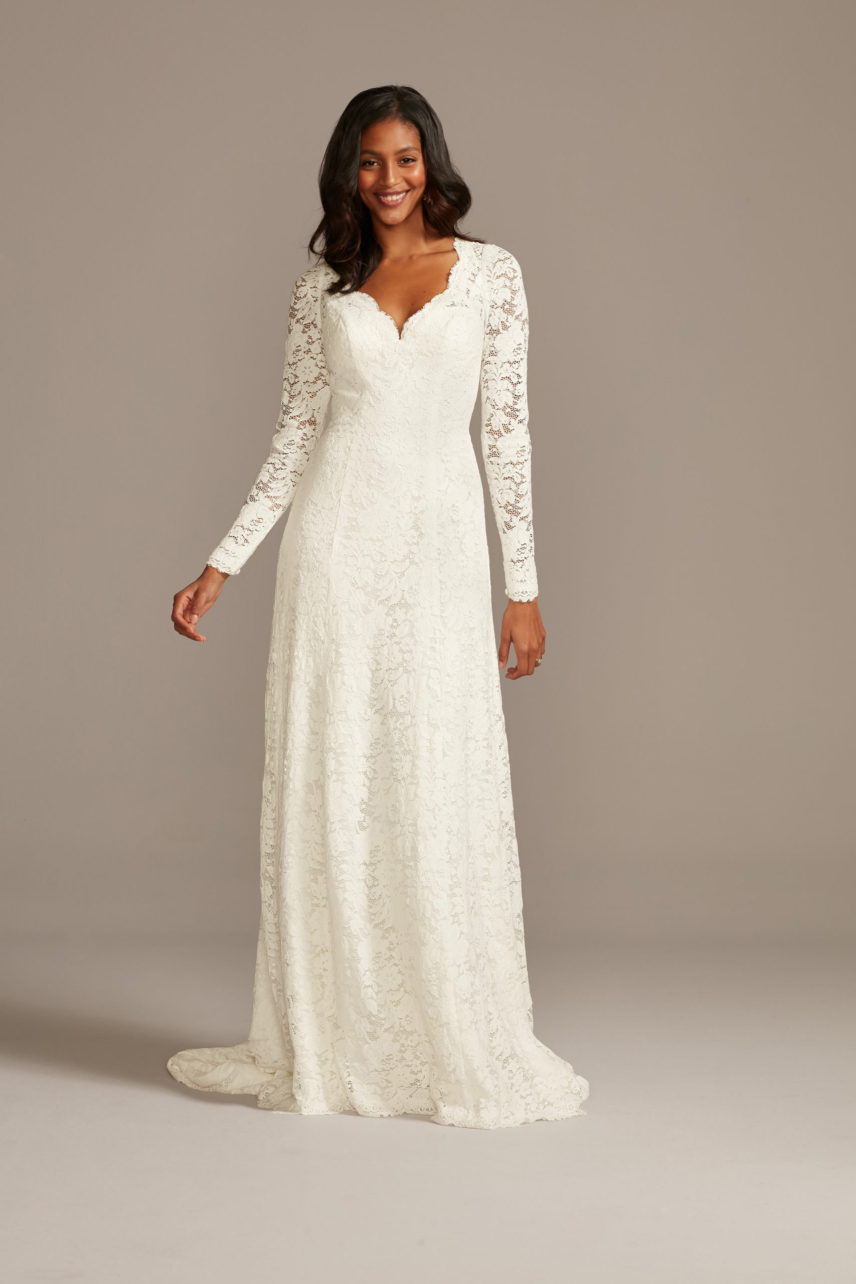 Bride wearing a wedding dress with long sleeves