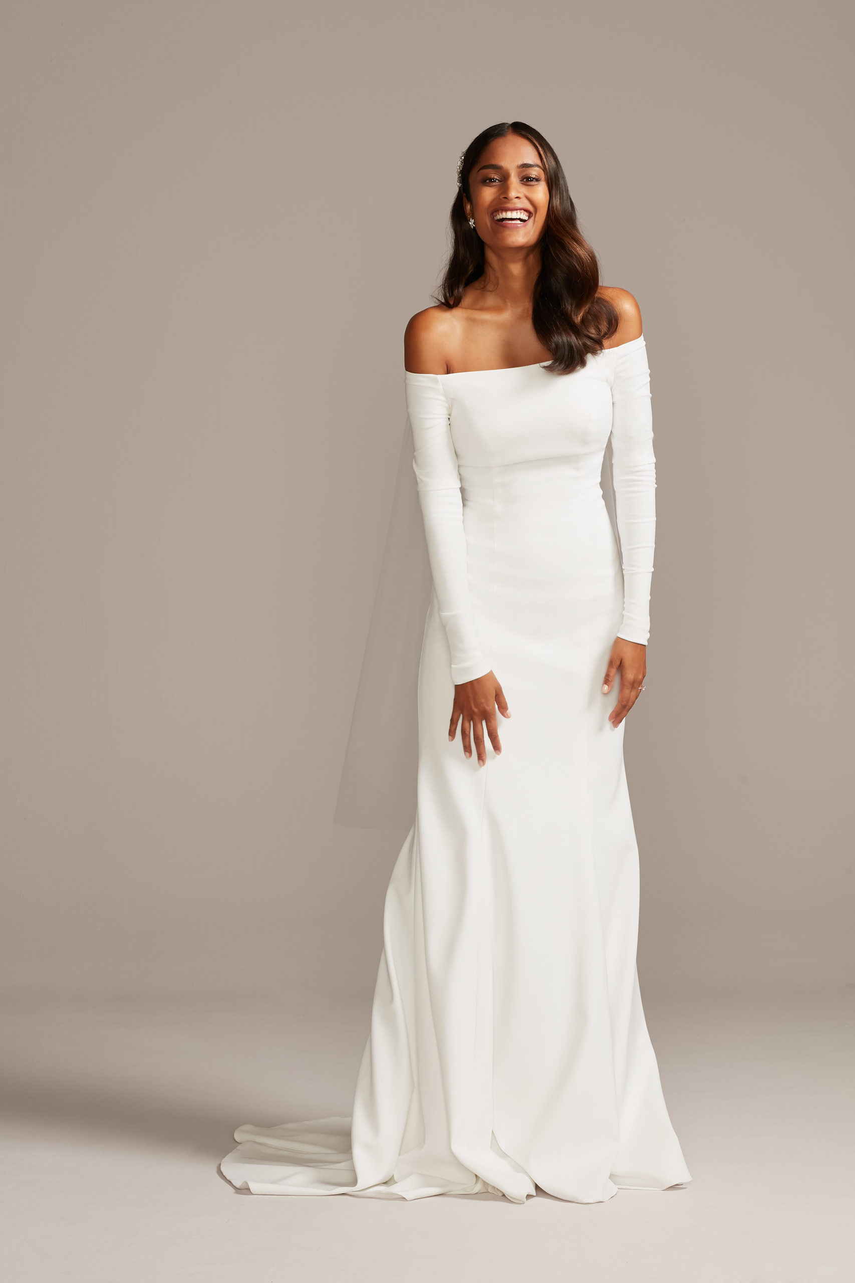 bride wearing wedding dress with off the shoulder sleeves