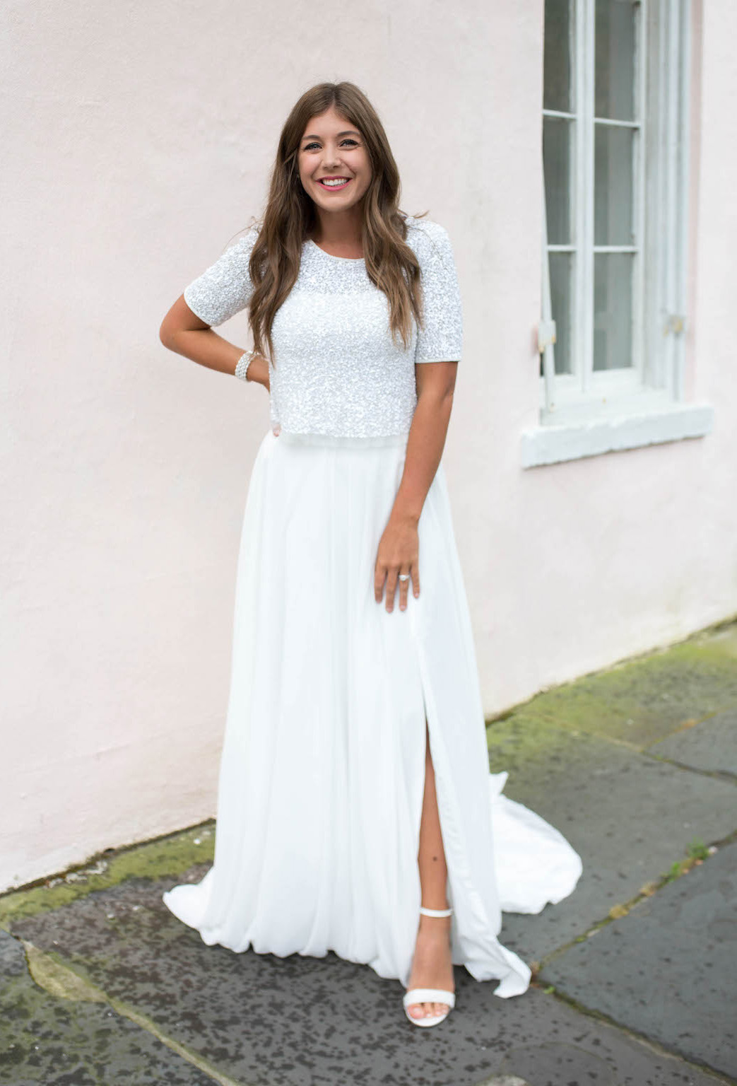 bride wearing a two piece bridal set with a sequin top and chiffon skirt