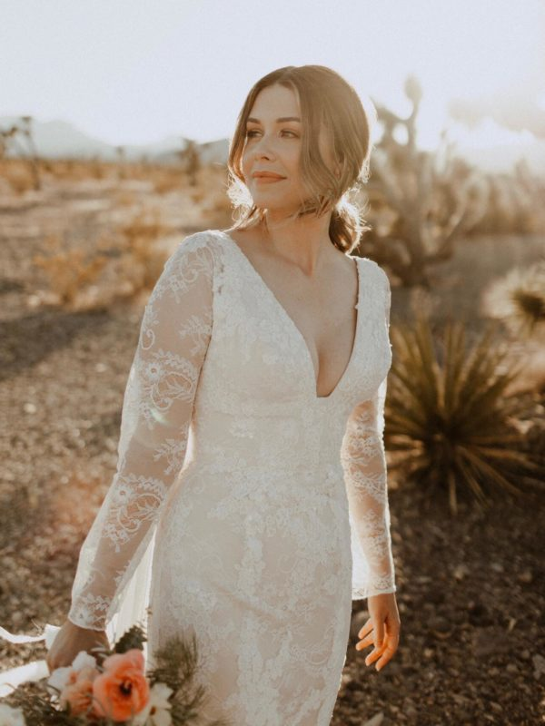 bride wearing wedding dress with long sleeves