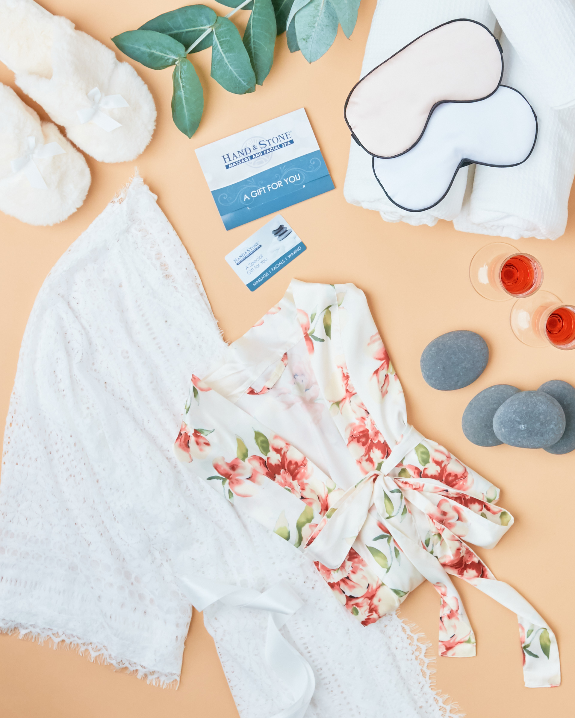 white and floral robe flatlay with fluffy white slippers