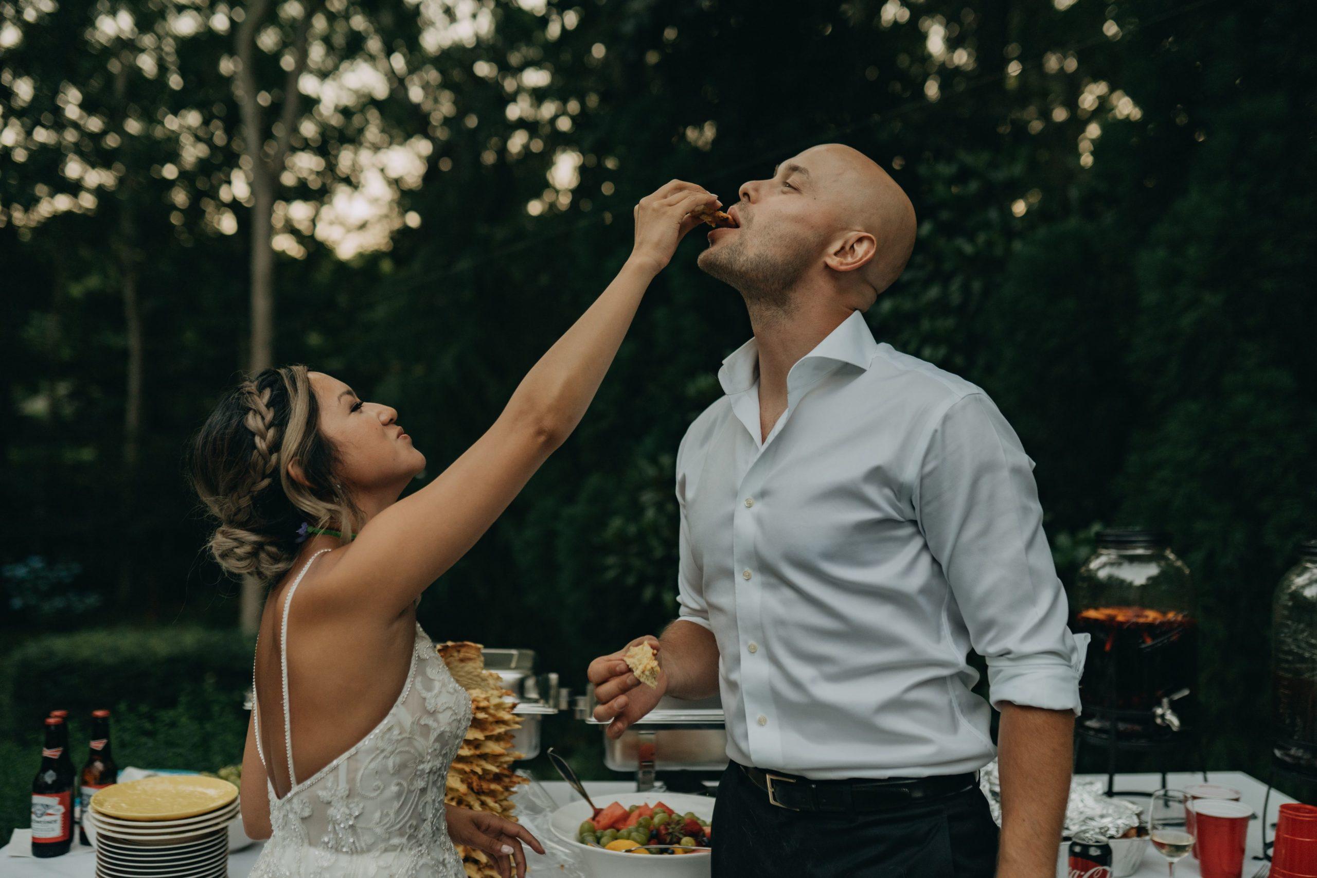 bride serving groom cake