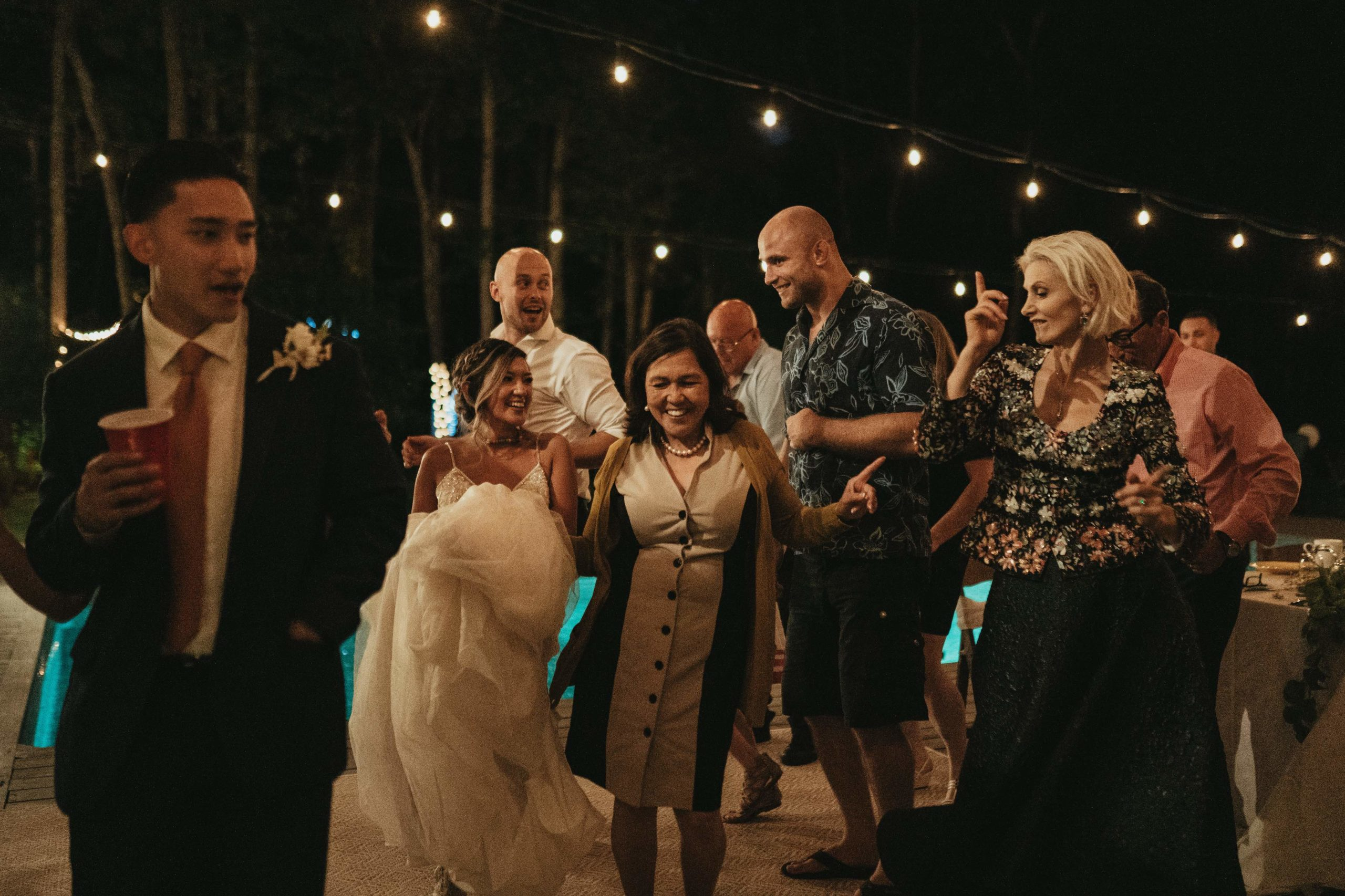 Family dancing at night