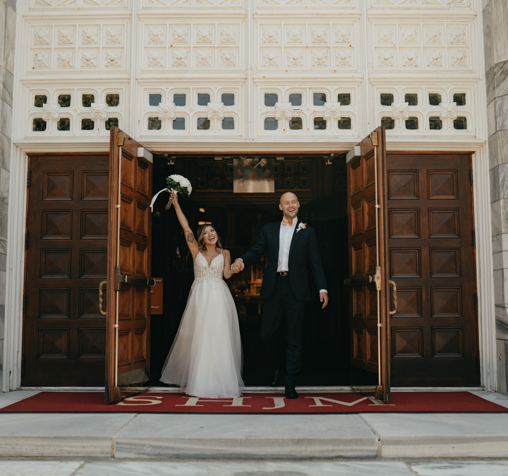 Bride and groom leaving ceremony as newlyweds