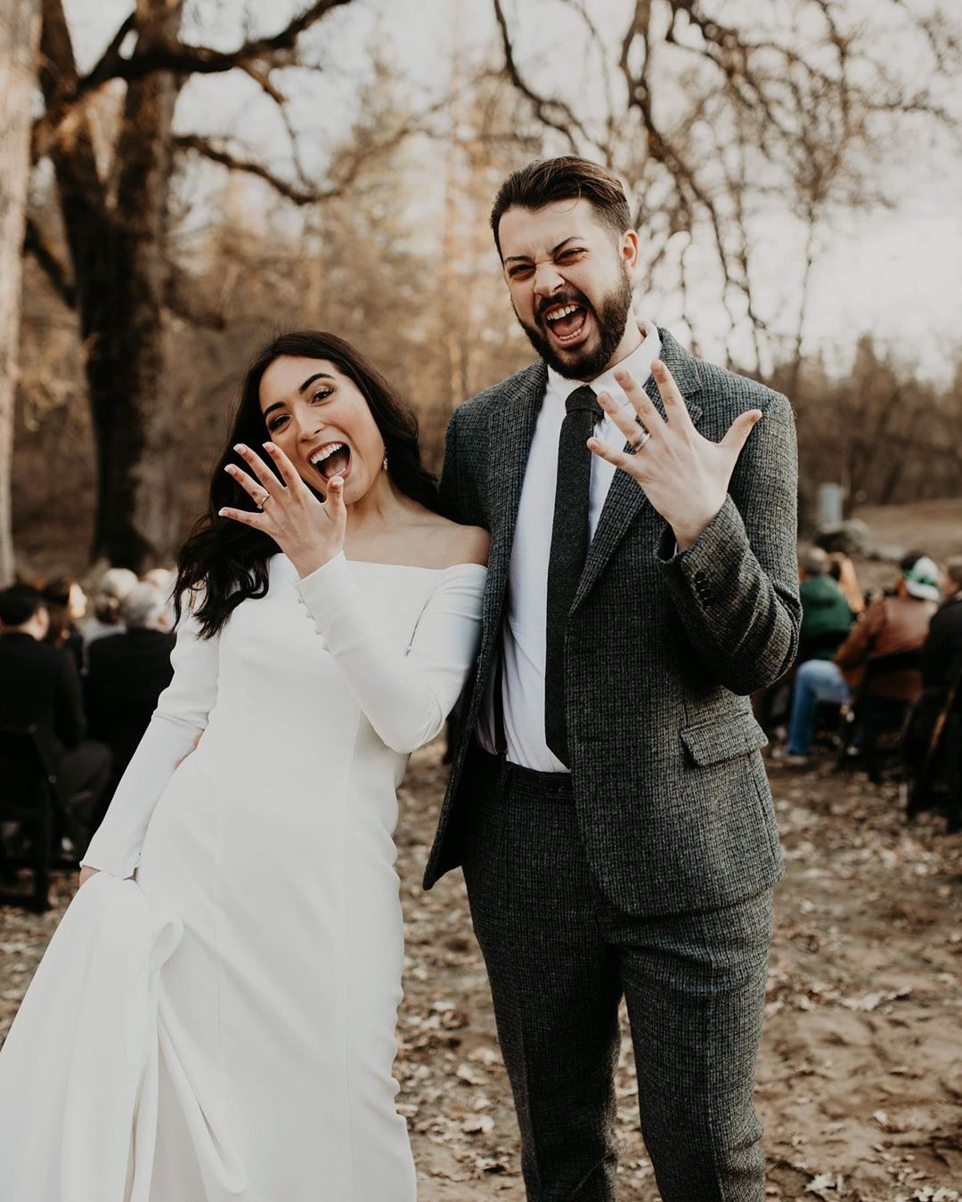 Bride and Groom holding wedding bands ups