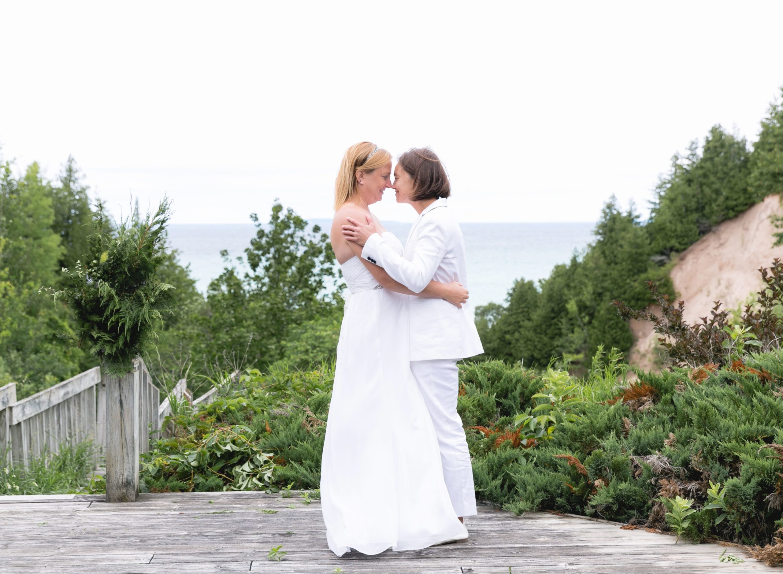 Rachel and Sarah embracing in front of Lake Michigan