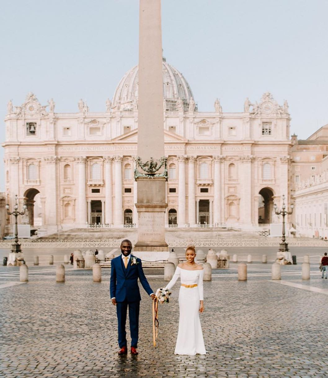 Bride and Groom holding hands in Italian plaza