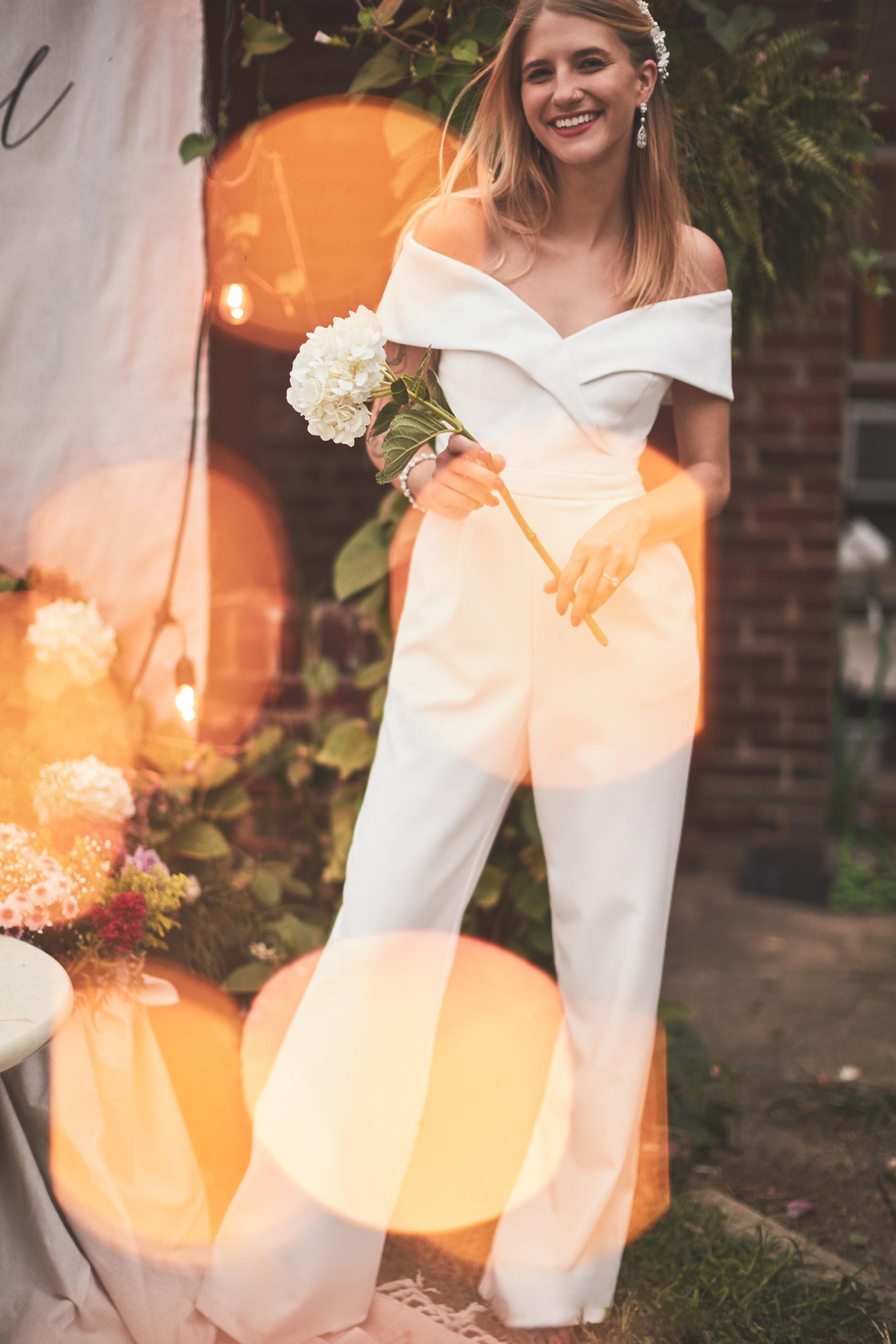 Bride in white jumpsuit