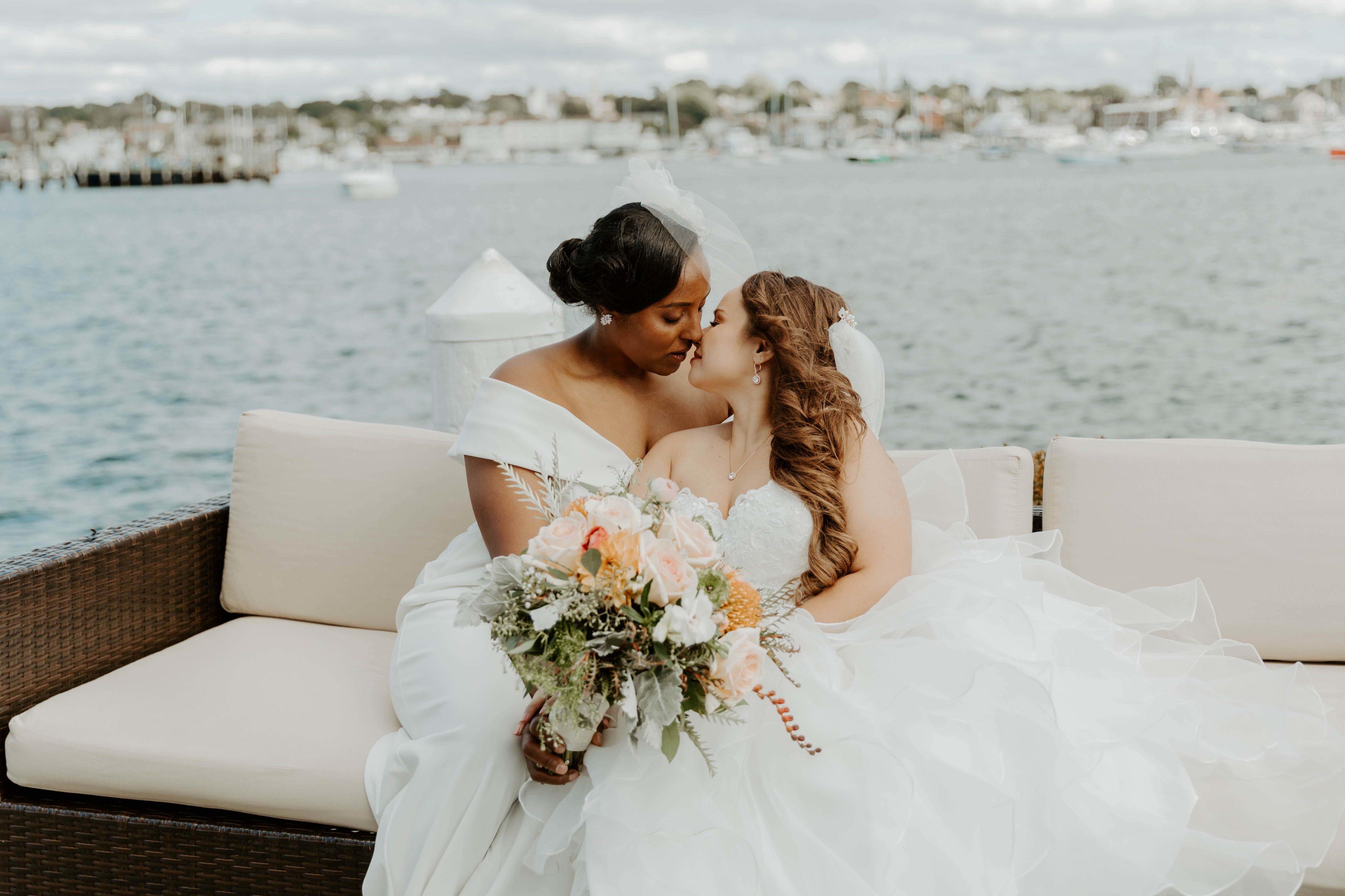 Kristina and Kindell kissing on dock