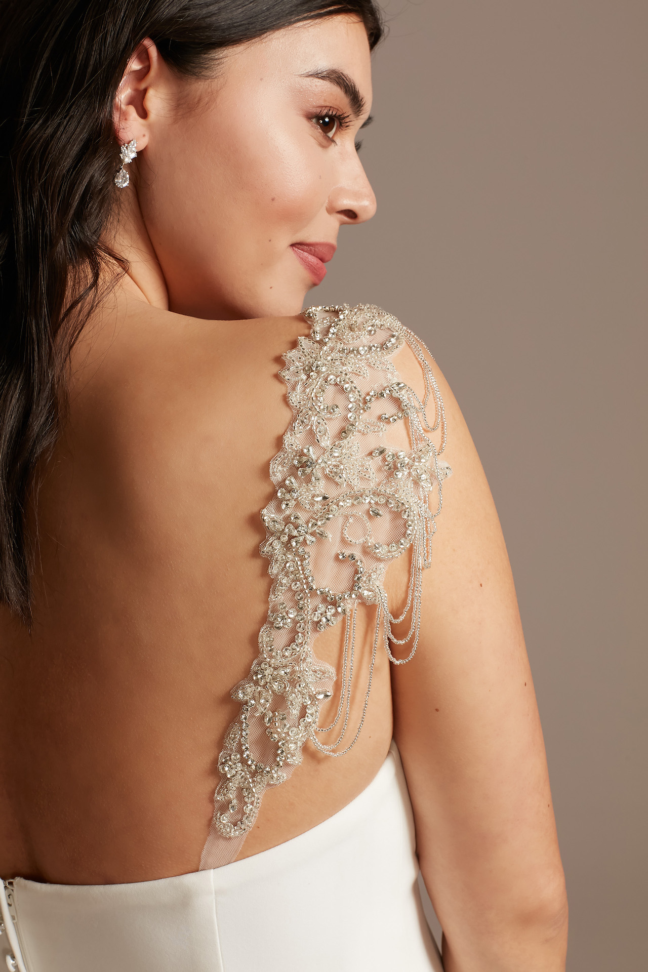 bride with ornate beaded straps on her dress