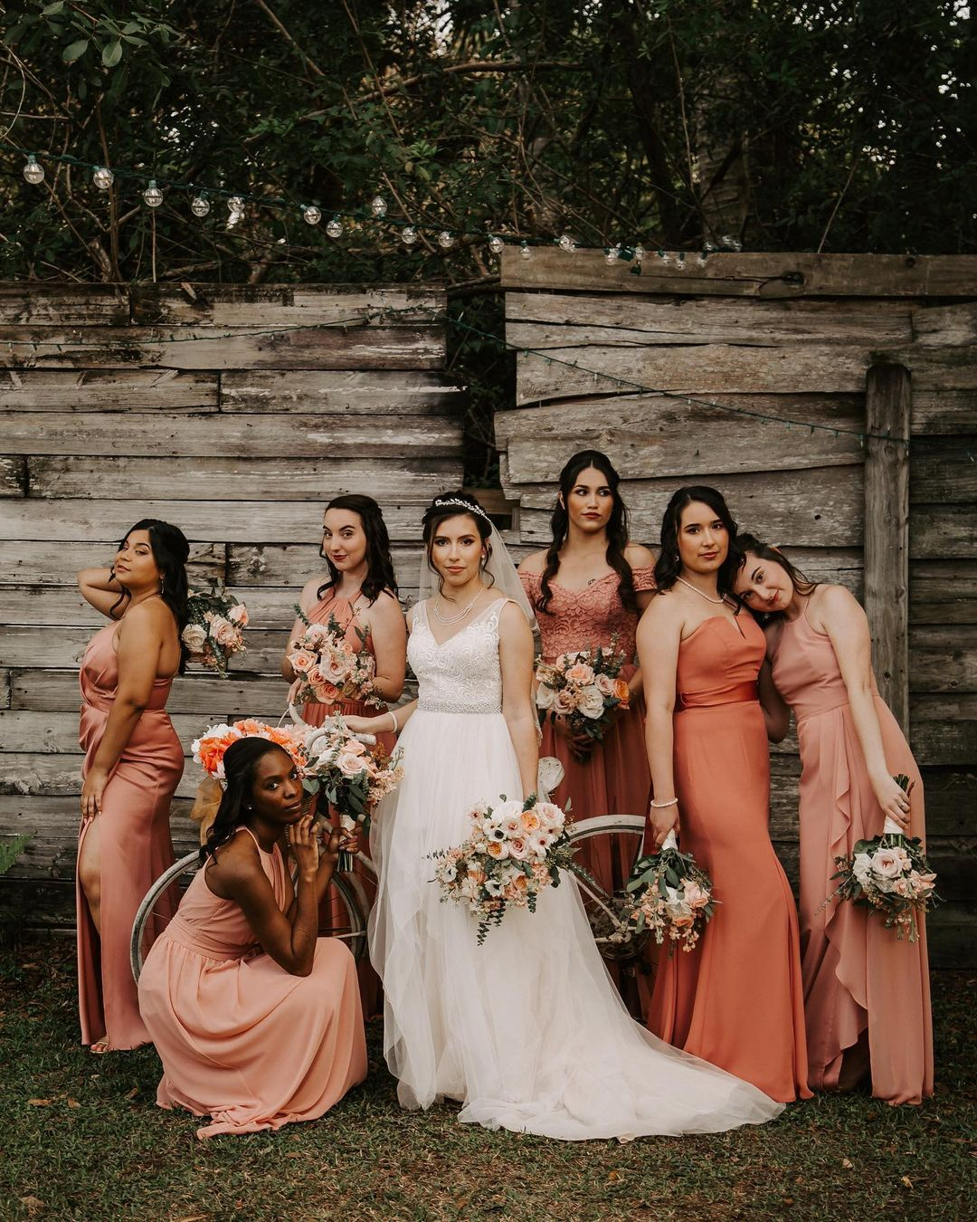 bride and bridal party in sunset hues