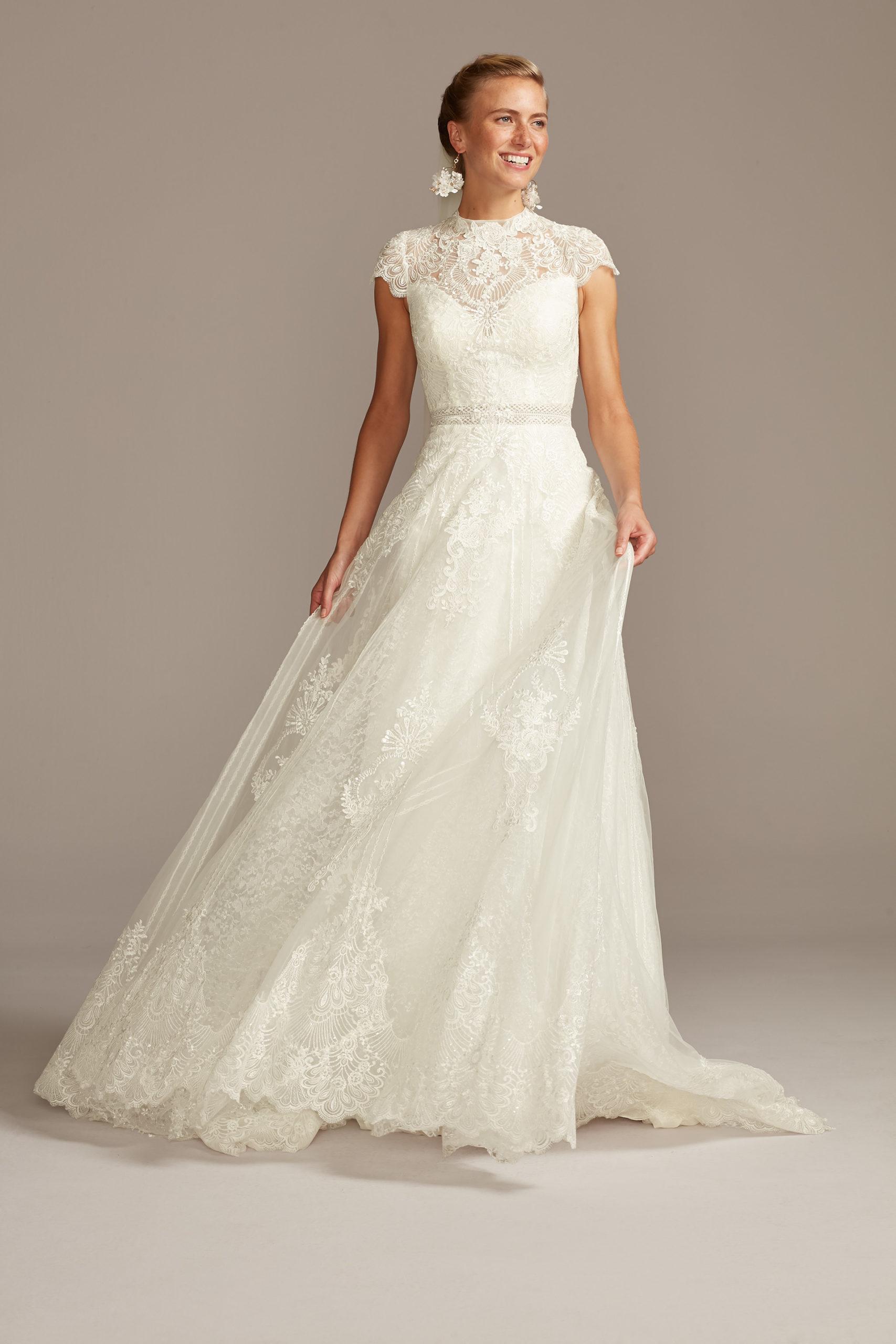 Bride wearing lace wedding dress with mock neck neckline