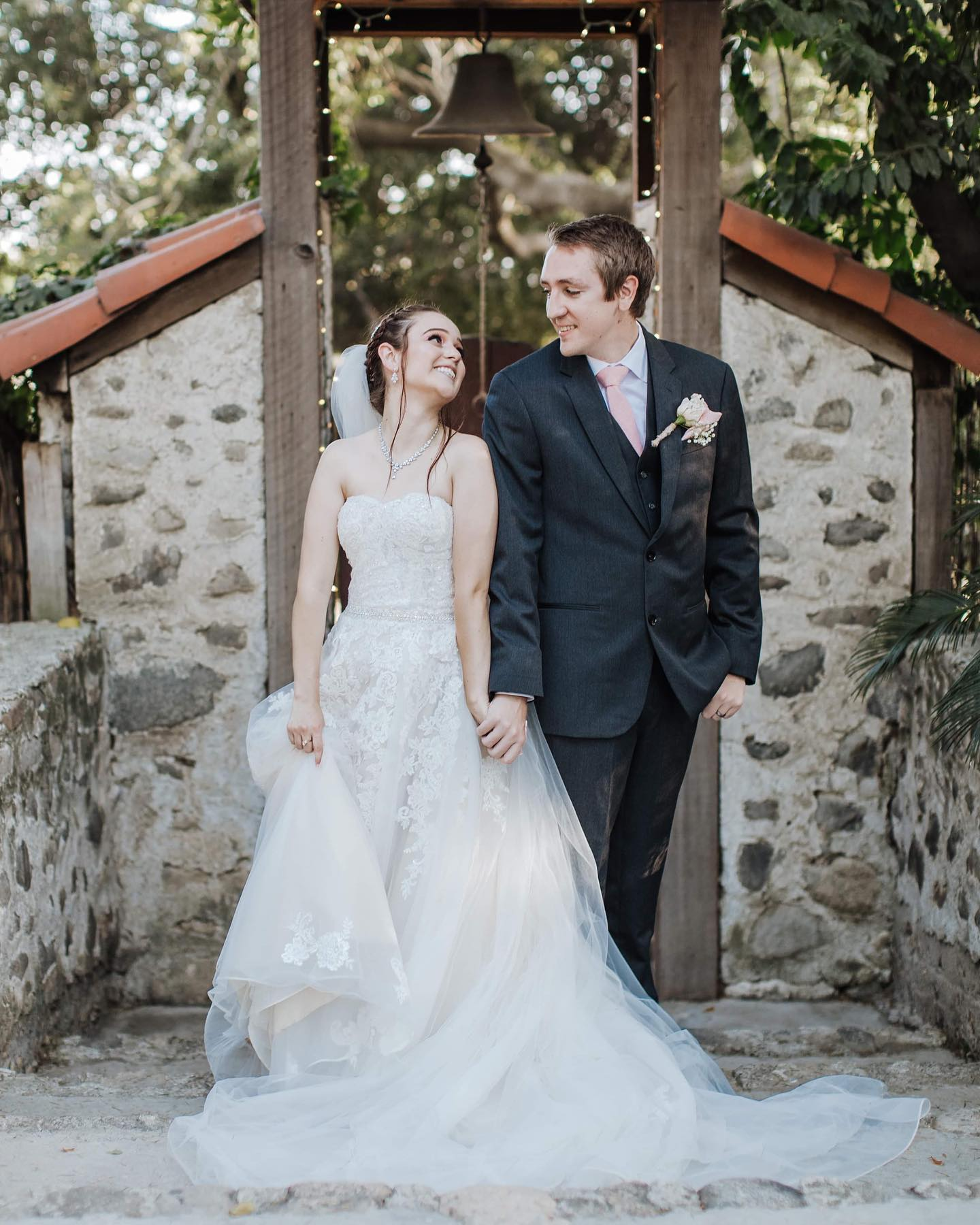 bride wearing traditional ball gown with lace and tulle