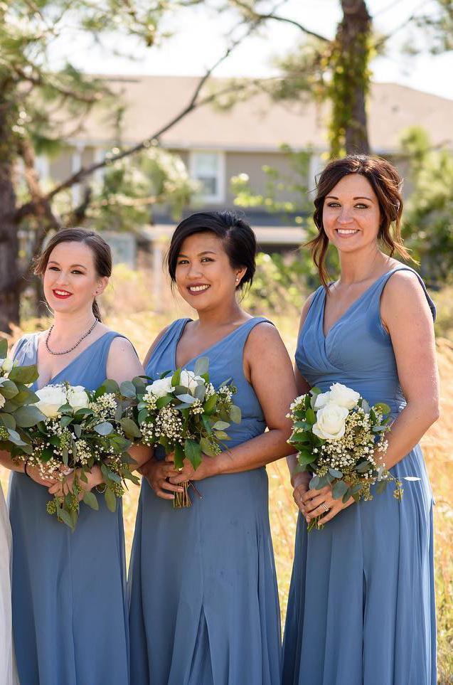 bridesmaids in matching blue chiffon bridesmaid dresses