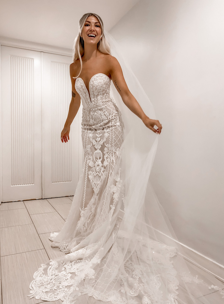 bride wearing a mermaid silhouette gown with intricate lace appliques