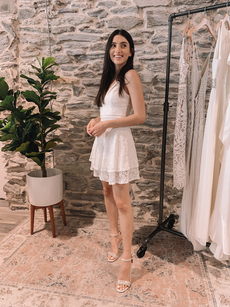 Bride in short fit and flare white dress