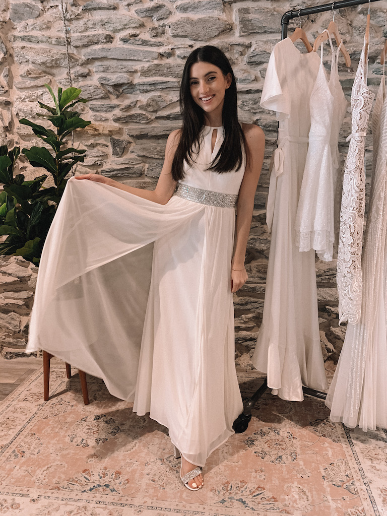 bride in long white dress with flowy mesh skirt